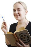Girl taking a note Stock Images