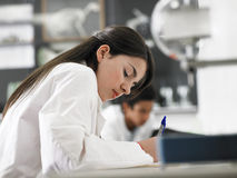 Girl Taking Notes In Science Class Royalty Free Stock Photo