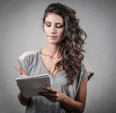 Girl taking notes Royalty Free Stock Photos