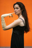 Girl taking off her glove. With teeth Royalty Free Stock Image
