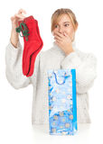 Girl taking out gift from present bag Royalty Free Stock Image