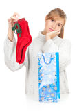 Girl taking out gift from present bag Stock Images