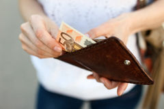 Girl is taking out money from wallet Royalty Free Stock Photos