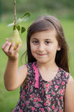 Girl taking a pear Royalty Free Stock Photo