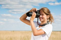 Girl taking photo Royalty Free Stock Image
