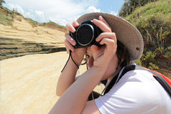Girl taking a photo Stock Photography