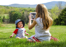 Girl Taking Photo of Baby royalty free stock images