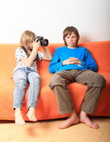 Girl taking photo of boy Royalty Free Stock Photography