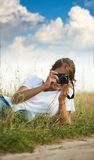 Girl taking photo with camera Royalty Free Stock Photos