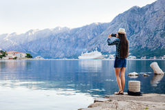 Girl taking photo of cruise liner stock photos