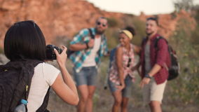 Girl taking photo of friends while traveling stock video footage