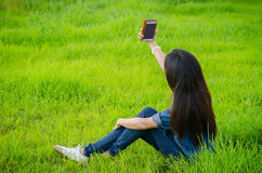 Girl taking photo herself by smart phone Stock Image