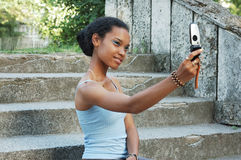Girl taking photo on mobile Royalty Free Stock Image
