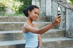 Girl taking photo on mobile royalty free stock image