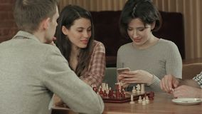 Girl taking photo of playing chess stock video footage
