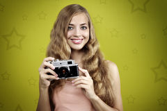 Girl taking photo with retro camera Royalty Free Stock Photo