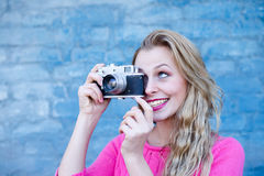 Girl taking photo on retro vintage hipster camera Stock Image