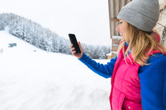 Girl Taking Photo On Smart Phone Snowy Mountain Young Woman Winter Snow Royalty Free Stock Photo