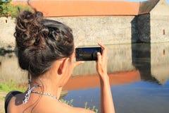 Girl taking photo of Svihov castle Stock Images