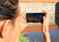 Girl taking photo of Svihov castle Stock Photography