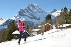 Girl in the Swiss Alps. Girl taking a photo in the Swiss Alps Stock Image