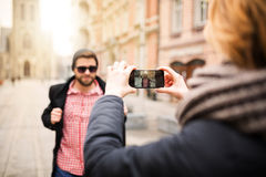 Girl taking a photo to her boyfriend Royalty Free Stock Images