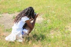 Girl taking photo Stock Photo