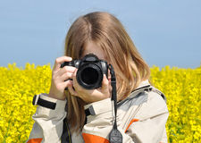 Girl taking photos Stock Image