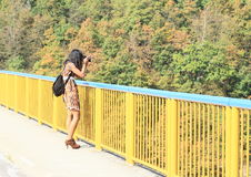 Girl taking photos from bridge Royalty Free Stock Images