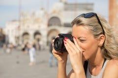 Girl taking photos with digital camera Stock Photos