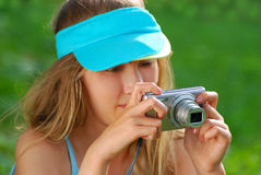 Girl taking photos by digital camera Royalty Free Stock Photos