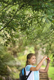 Girl Taking Photos In Forest Stock Photo