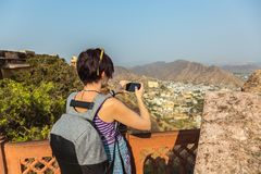 The girl is taking photos in Fort Amer. India