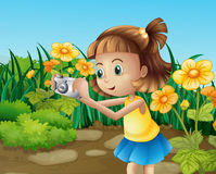 A girl taking photos at the garden Royalty Free Stock Images