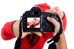 Girl taking photos to a santa woman in christmas Stock Photography