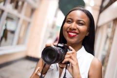 Girl taking photos Royalty Free Stock Photos