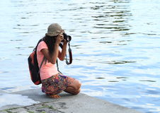Girl taking photos Stock Images