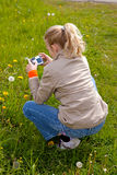 Girl is taking a picture Royalty Free Stock Photos