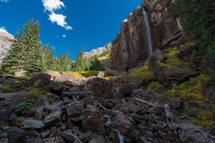 Girl taking picture of Bridal Veil Falls Telluride Colorado USA Royalty Free Stock Photo