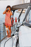 Girl taking picture while sailing Stock Image