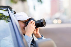 Girl taking picture car Stock Photography