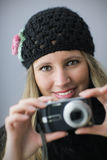 Girl taking a picture with digital camera Stock Image