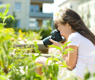 Girl taking picture on natural, outdoor Royalty Free Stock Image
