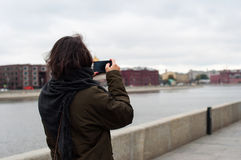 Girl taking picture with the phone. On the bank of Moscow-river stock images