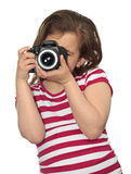 Girl taking a picture with a professional camera Royalty Free Stock Images