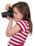 Girl taking a picture with a professional camera Stock Image