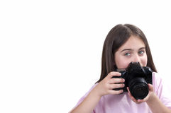 Girl taking a picture with a professional camera Stock Photography