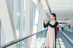 Girl taking picture while on the moving walkway royalty free stock image
