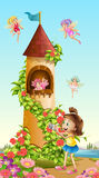 Girl taking picture of tower with fairies Royalty Free Stock Photo