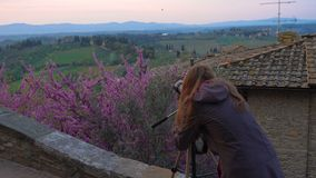Girl taking a picture of tuscanian landscape stock video footage